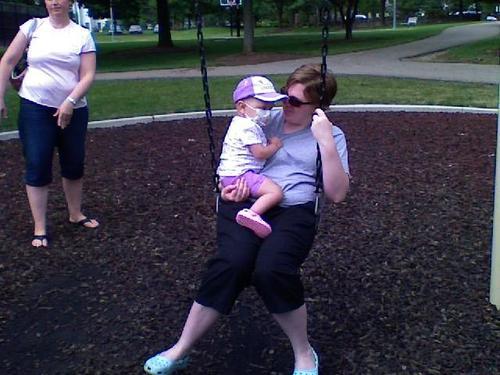 Swinging with Mom.